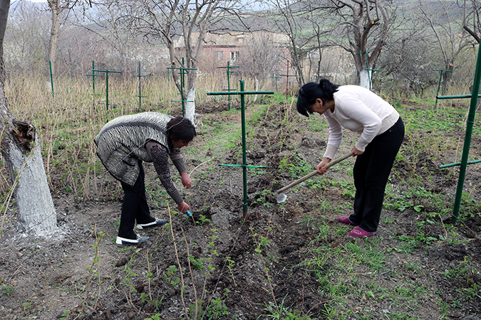 Lusine Yazoulyan and another member of the Ashotavan community Women's Group, working on their new raspberry orchard. Green Lane is providing them with seedlings and beehives. Photo: Green Lane/Armen Sarukhanyan