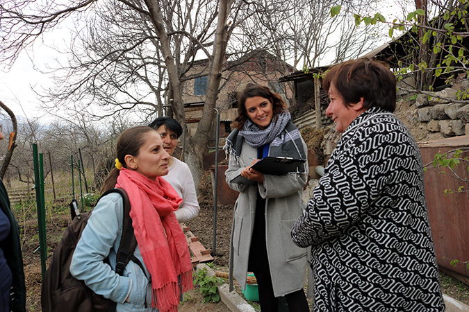 Catherine Wolf and Zabel Hayruni of Green Lane, talking to beneficiaries in the community of Ashotavan. Photo: Green Lane/Armen Sarukhanyan