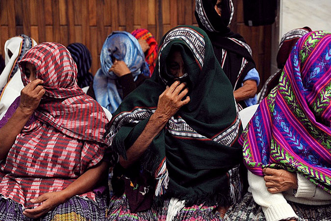 """""""The Sepur Zarco Grandmothers"""" wait for a verdict during the trial of  former military officers for crimes against humanity on counts of rape, murder and slavery in Guatemala's High-Risk Court. Photo: Cristina Chinquin"""