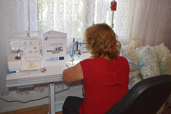 A survivor of conflict-related sexual violence in Kosovo works on pillow production, after receiving a micro-grant. Photo: Dorina Babuni