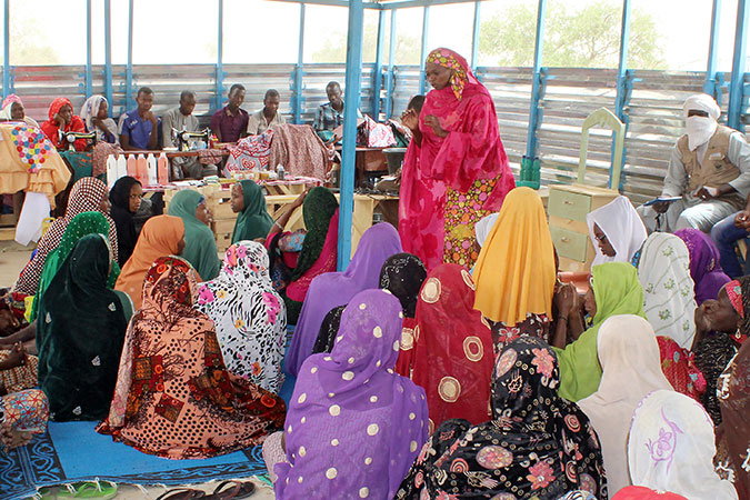 Women listen to a presentation inside the women's cohesion space in the refugee camp of Sayam Forage in the Diffa region. Photo:  REJEA – Niamey