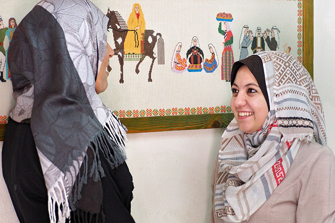 Faten Ashour (left) ended her 13-year abusive marriage with legal help from Ayah al-Wakil. Photo: UN Women/Eunjin Jeong