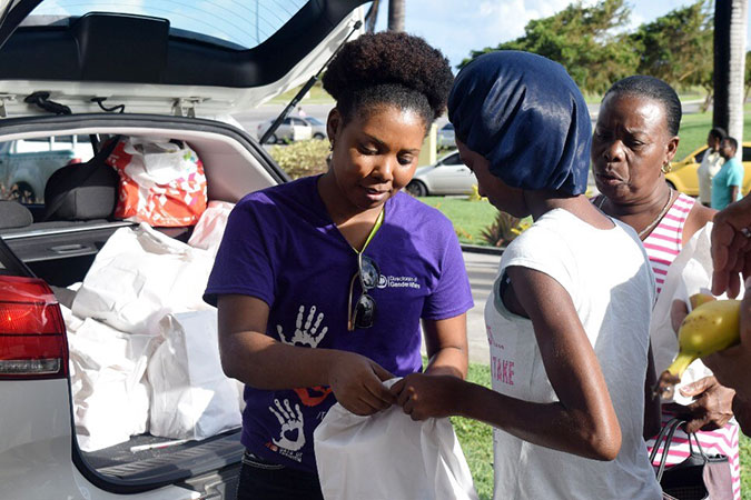 Farmala Jacobs, acting Executive Director of the Directorate of Gender Affairs, distributes dignity kits following Hurricane Irma in Barbuda.  Photo: Antigua and Barbuda Directorate of Gender Affairs/Nneka Nicholas
