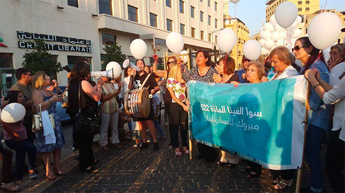 Civil society activists from ABAAD, the Lebanese Women Council, and others gather outside of the parliament building in Beirut to celebrate the abolishment of article 522 from the Lebanese Penal Code on 17 August 2017. Photo: ABAAD