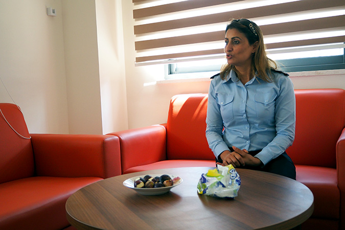 Major Abla Fazaa, the Head of the Family and Juvenile in Ramallah who is also heading the One Stop Centre, explains the challenges that Palestinian women survivors of violence experience and how the One Stop Centre is supporting them. Photo: UN Women/Eunjin Jeong