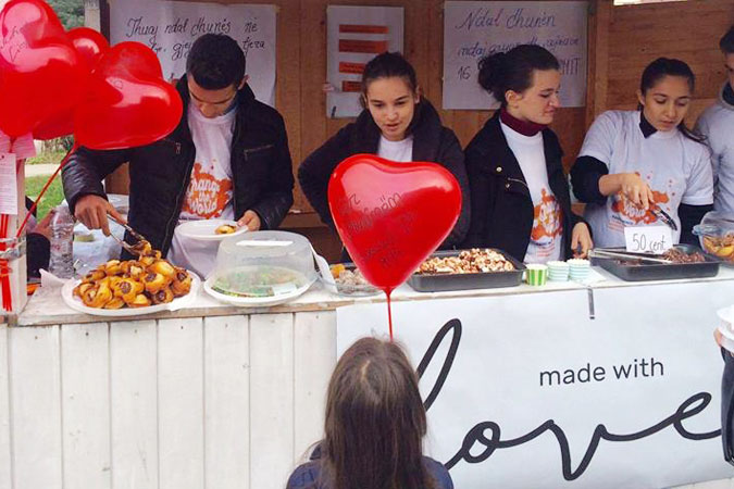 Members of the Made with Love team sell baked goods made by survivors of violence. UN Women/ Ina Cenko