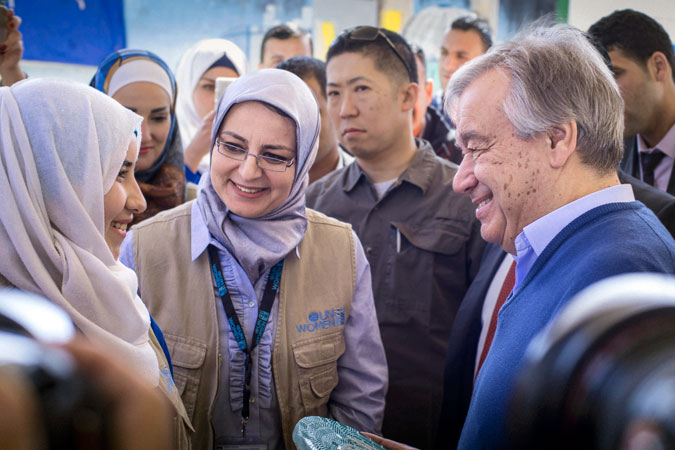 Secretary-General António Guterres received a mosaic made by Syrian women refugees participating in the UN Women handicraft workshop in the Za'atari refugee camp. In this photograph, the mosaic is handed over by Manar Al Nabulsi, a young refugee woman who benefitted from her work in the Oasis. Photo: UN Women/ Benoît Almeras