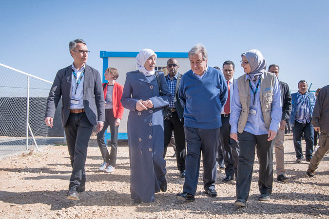 UN Secretary-General António Guterres arrives at the UN Women center in the Za'atari refugee camp and is welcomed by Ibtisam Majareesh, head of the camp women's committee and member of the camp refugee committee, Ziad Sheikh, UN Women Jordan Representative, and Heba Zayyan, Recovery Specialist at UN Women Jordan. Photo: UN Women/ Benoît Almeras