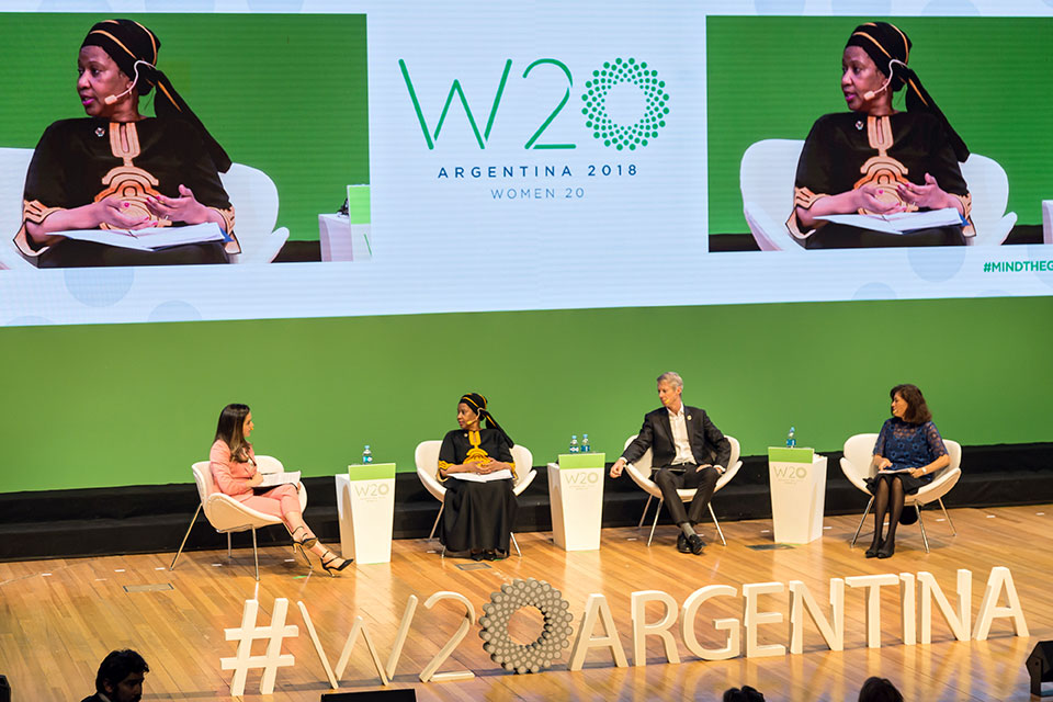 Heather Barnabe, CEO, G(irls)20; UN Women Executive Director Phumzile Mlambo-Ngcuka; Mats Granryd, Director General, GSMA; and Gabriela Ramos, Chief of Staff & Sherpa, OECD participate in a panel at the W20 Summit. Photo: UN Women/Rodrigo de la Fuente.