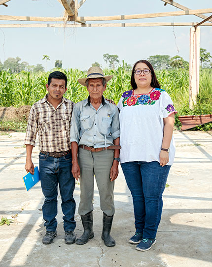 Paula Barrios stands with two community members. Photo: UN Women/Ryan Brown