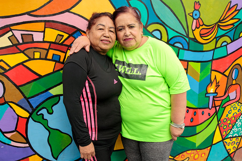"<p>Martha Lidia Aleman and Maria del Rosario Hernandez, residents of Zone 5, Guatemala City, pose in front of the murals they painted as part of the Guatemala Safe City programme. ""This place has changed a lot. Women used to be afraid to pass by these places before,"" said  Aleman. ""Now, the park is like my second home!"