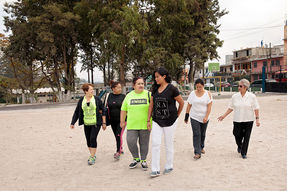 <p>Women from the neighborhood group walk through rejuvenated sports    </p>