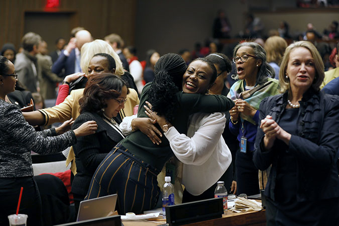 Participants at the 62nd session of the UN Commission on the Status of Women rejoice as the Commission adopts Agreed Conclusions to ensure the rights and development of rural women and girls. Photo: UN Women/Ryan Brown