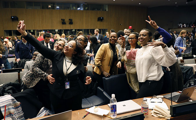Participants at the 62nd session of the UN Commission on the Status of Women celebrate the adoption of CSW62 Agreed Conclusions Photo: UN Women/Ryan Brown