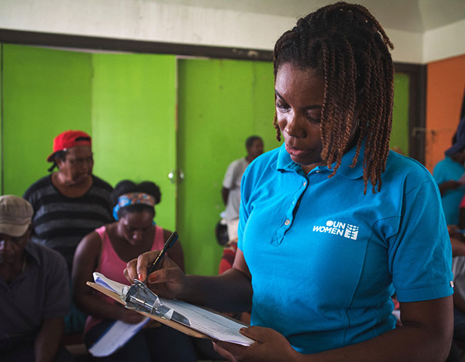 UN Women Programme Specialist Isiuwa Iyahen conducts a Post Disaster Needs Assessment in October 2017, following the September 2017 hurricane in Dominica. Photo: UN Women/Sheldon Casimir