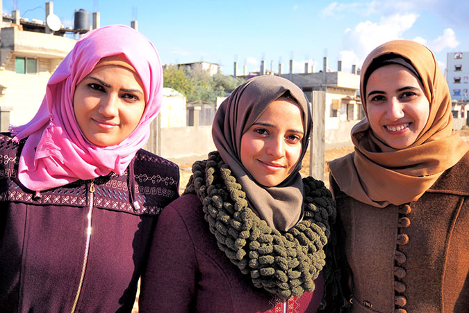 From left: Samah Al-Nahal, Dalia Osama and Nihal Zourob are three female architects who completed the blueprint of the public garden in Al-Shoka neighborhood in collaboration with the community members. Photo: UN Women/Eunjin Jeong