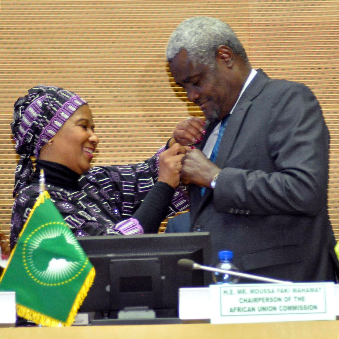 The Chairperson of African Union, Moussa Faki Mahamat received the HeForShe pin from UN Women Executive Director during the opening ceremony. Photo: UN Women