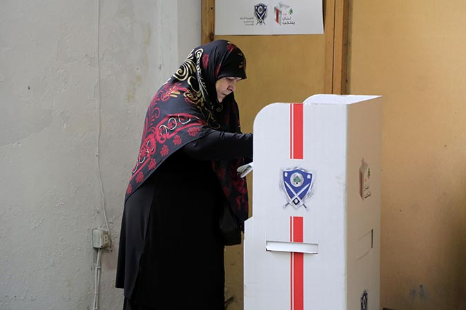 A woman casts her vote in Lebanon's parliamentary elections. Photo: UN Women/Jean Safi
