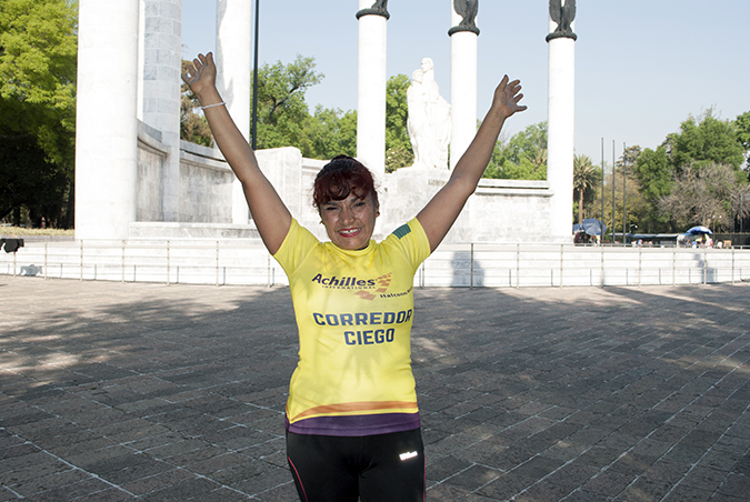 Palmira Martinez celebrates after completing the Carrera Bonafont con Causa 5k. Photo:  UN Women