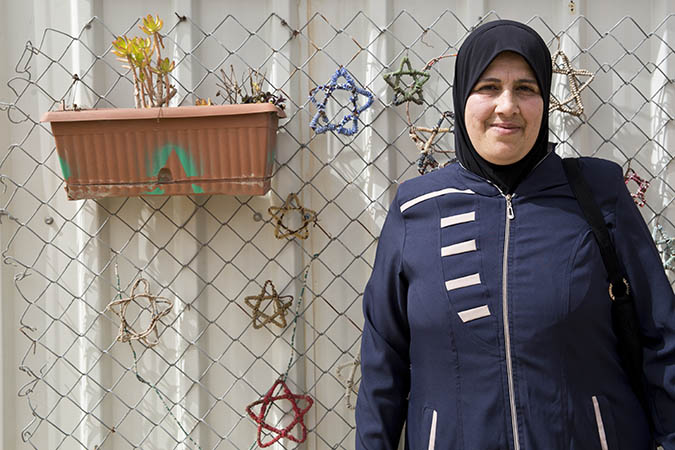 Maha Aasi Emm Ala'a, 48, Syrian refugee woman enrolled in the UN Women's cash-for-work programme as tailor in the 'Oasis Center for Resilience and Empowerment of Women and Girls' operated by UN Women in the Za'atari refugee camp. Credits: UN Women/Lauren Rooney
