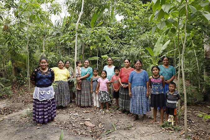 Women of Puente Viejo, a small indigenous community across the Polochic and Malazas rivers, pose for a photo. Photo: UN Women/Ryan Brown