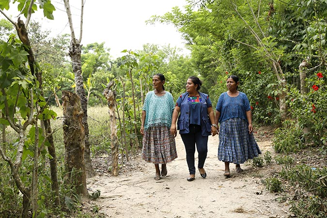 The UN Women-supported economic programme has helped women from the community to become economically self-sufficient. At right is 55-year-old Candelaria Pec, whose living conditions have improved. Photo: UN Women/Ryan Brown
