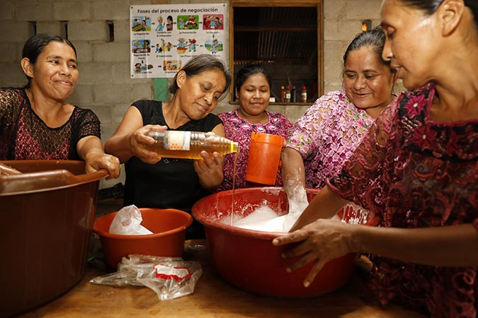 Women from Aldea Campur, in Alta Verapaz, market and package their own shampoo, earning extra income for themselves and for their families. Photo: UN Women/Ryan Brown