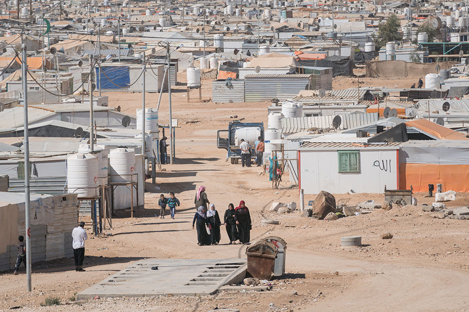 Women walk through the Zaatari Refugee camp in Jordan.