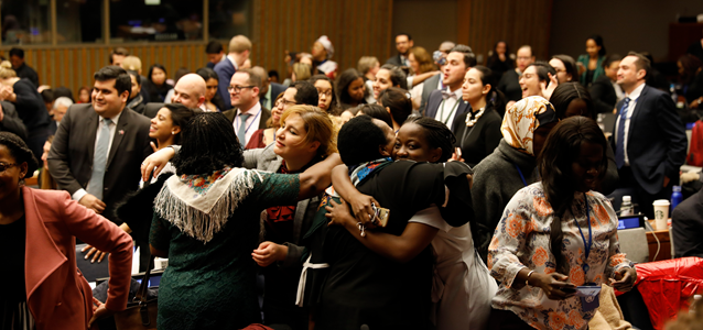 Participants rejoice as the 63rd session of the UN Commission on the Status of Women delivers roadmap on ensuring women's social protection, mobility, safety, and access to economic opportunities. Photo: UN Women/Ryan Brown
