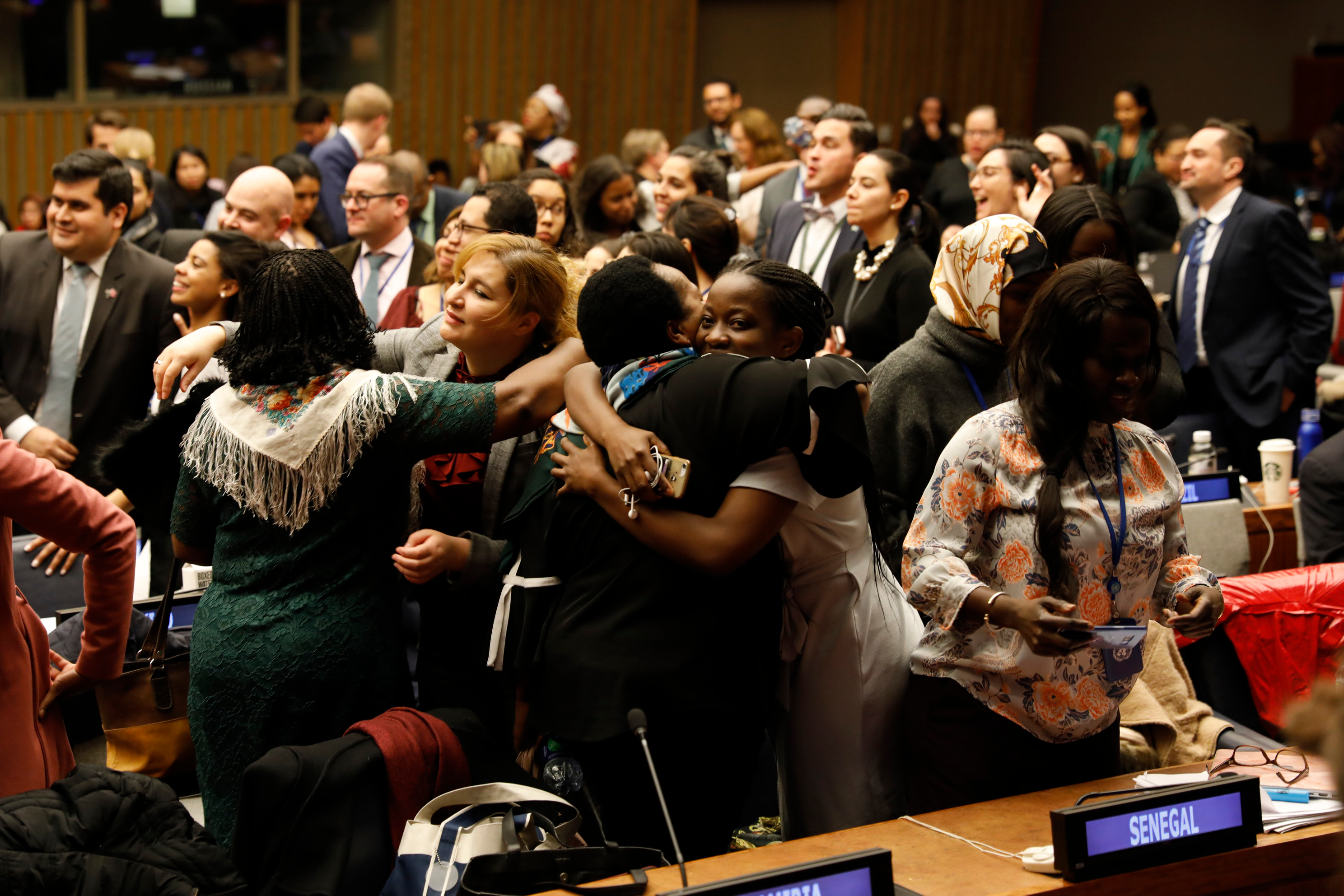 Participants rejoice as the 63rd session of the UN Commission on the Status of Women adopts Agreed Conclusions that delivers road map on ensuring women's social protection, mobility, safety, and access to economic opportunities. Photo: UN Women/Ryan Brown
