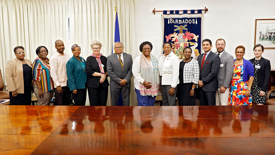In Barbados, the UN Women Executive Board delegation meets with Prime Minister Mia Mottley (centre). Photo: UN Women/Ryan Brown