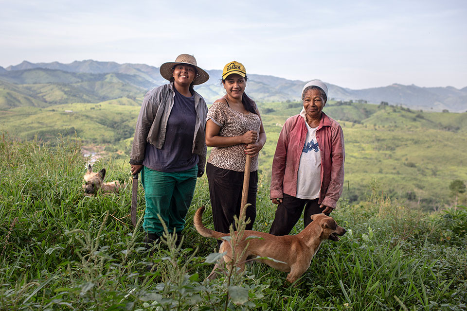 Janete Dantas, centre, with her mother, Maria Nilda, right, and her sister, Mayla, left, on their family farm. Photo: Lianne Milton