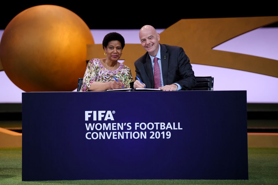 Gianni Infantino, FIFA President (R) and Phumzile MIambo-Ngcuka, United Nations Under-Secretary-General and Executive Director of UN Women (L) sign a Memorandum of Understanding during the FIFA Women's Football Convention  in Paris, France. Photo: Mike Hewitt - FIFA/FIFA via Getty Images