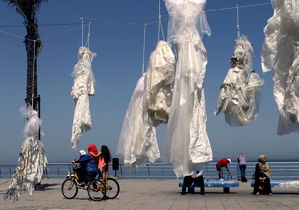 In Lebanon, activists hung tattered wedding dresses outside public buildings in order to draw attention to laws that forced women to marry their rapists. Photo: ABAAD by Patrick Baz /AFP