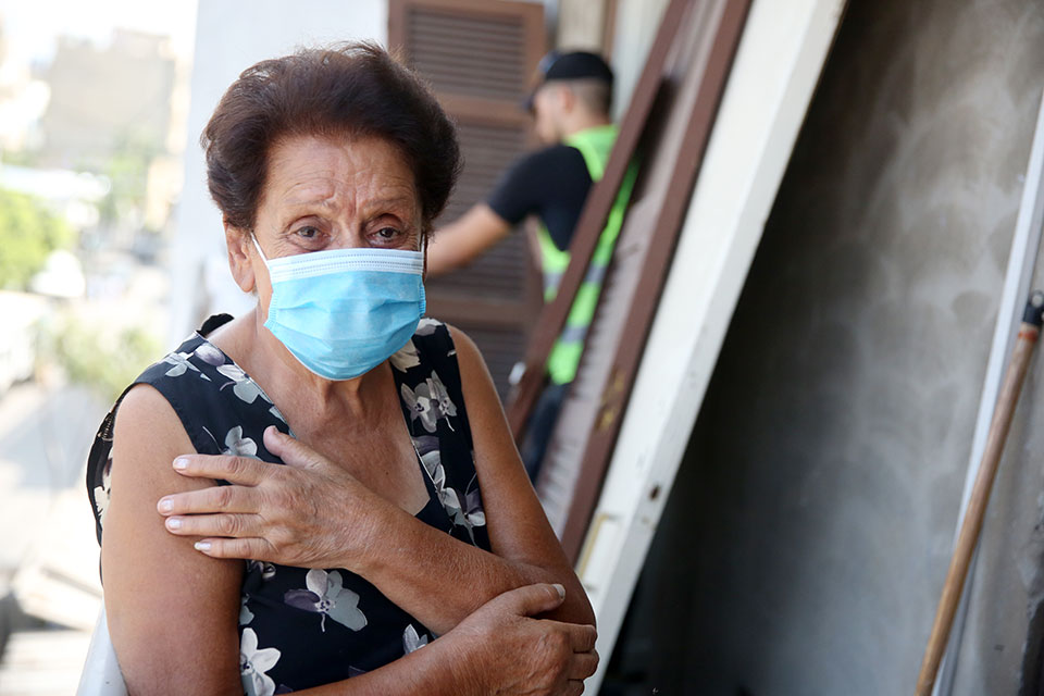 Violette Machaalany overseeing the work of the volunteers who came to fix her doors and windows. Photo: Dar Al Mussawir