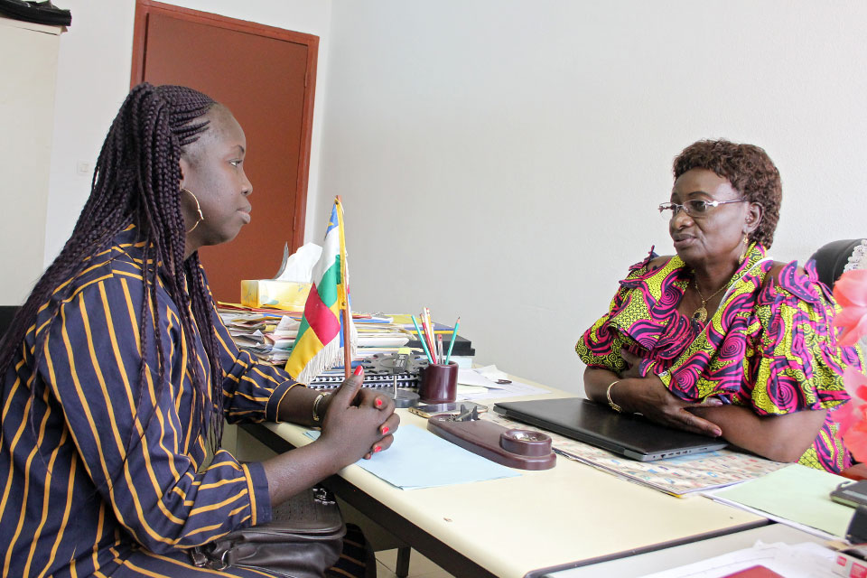 Marguerite Ramadan, Chairperson of the long standing Women Organisation OFCA, with Pamela Audrey Derom, recently elected Chairperson of the National Youth Council. Photo: UN Women/Novella Nikwigize