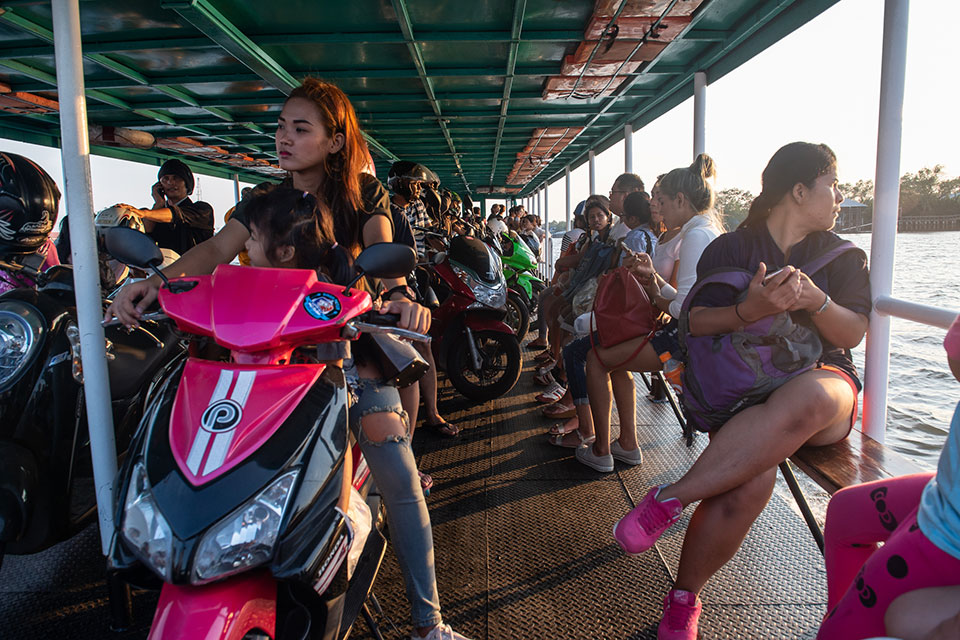 A woman and young child commuting via ferry, Thailand. Photo: UN Women/Pathumporn Thongking