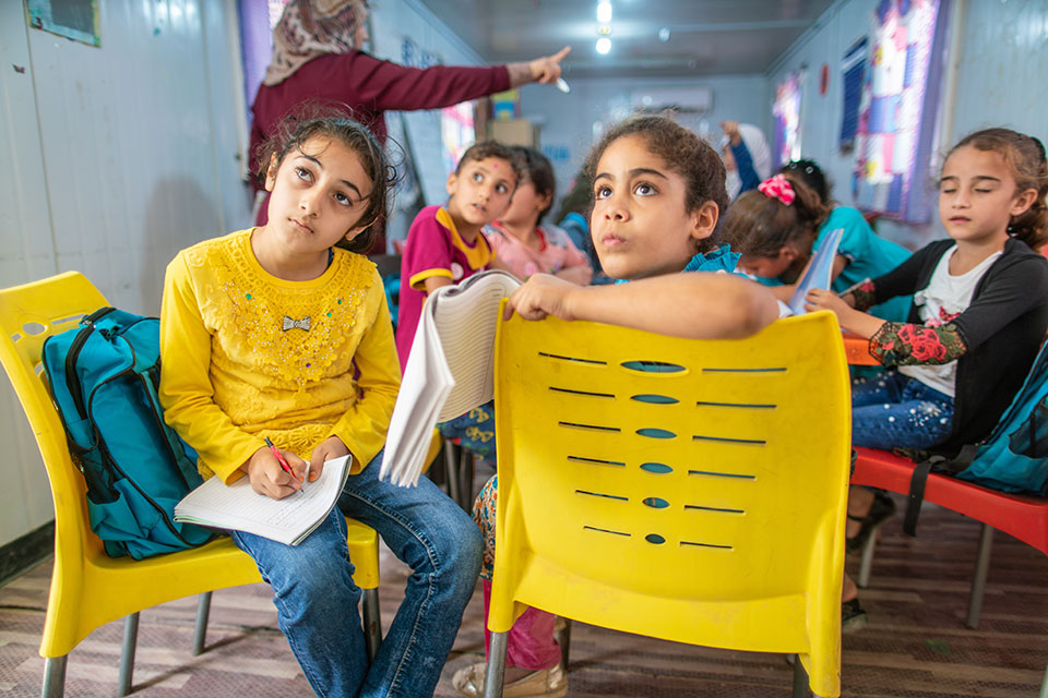 Students concentrate during their remedial education classes at the 'Oasis Center for Resilience and Empowerment of Women and Girls' operated by UN Women in the Za'atari refugee camp in Jordan. Photo: UN Women/Christopher Herwig