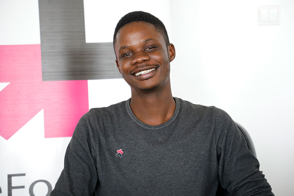 Jerry Azilinon is 23-year old He For She Champion who educates Senegalese boys and men on women's rights. Photo: UN Women/Khadidiatou Ndiaye