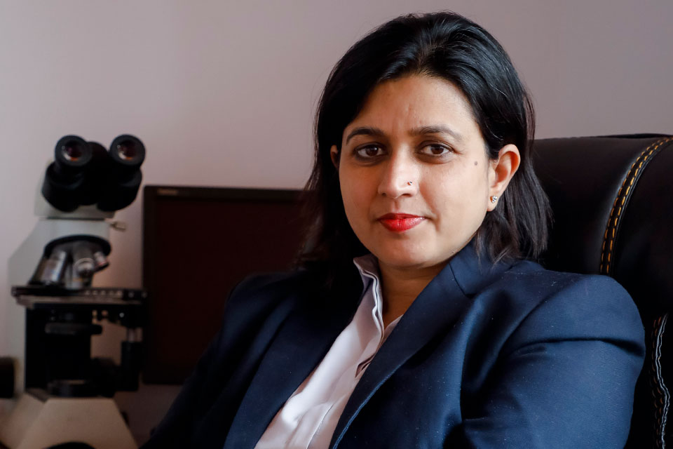 Dr. Runa Jha poses for a photo in her office. Photo courtesy  of Dr. Runa Jha.