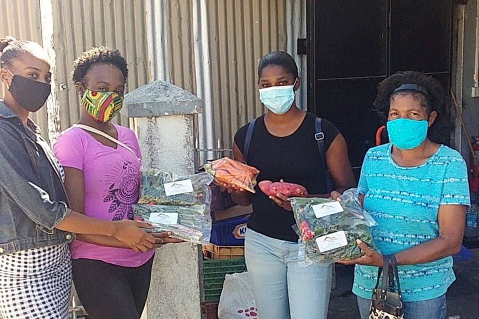 Kimara Lugay of Lindo Mart Supermarket, Lennisha Leblanc of Morne Prosper Women Farmers Group, Vanessa Julien of Warner Farmers Producers Inc., and Priscilla Jean Jacques of Morne Prosper. Photo: UN Women/Dawn Francis