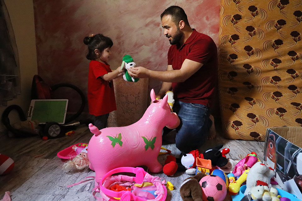 Mahmoud Charary and one-year-old Jouri enjoy playtime. Photo: Ramzi Haidar/Dar Al Mussawir for UN Women