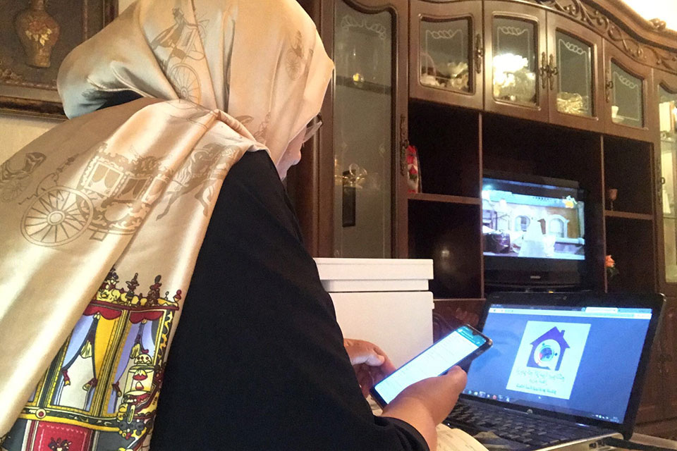 Women peacebuilders are using their mobile phones to support COVID-19 response efforts in Libya. Photos: Courtesy of Libyan Women's Network for Peacebuilding.