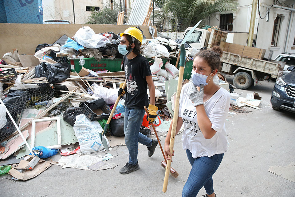 Lebanese youth team up to clean streets following the Beirut blast. Gemmayze, Beirut, August 6, 2020. Photo: Dar Al Mussawir