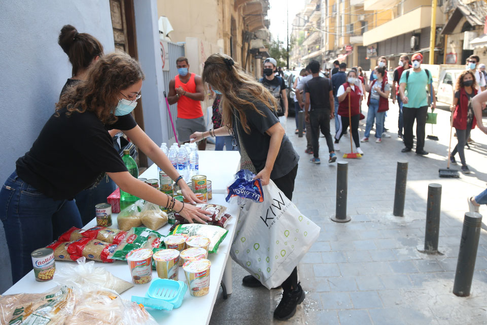 Young people distribute essential food to families in the Gemmayze neighborhood, Beirut on August 6, 2020. Photo: Dar Al Mussawir