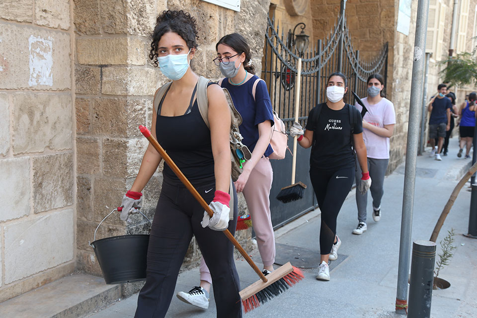Young women volunteers work to clean up and rebuild in Beirut. Photo: Dar Al Mussawir