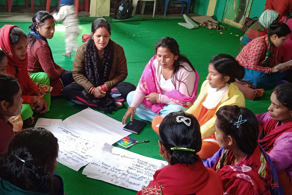 Laxmi Badi, center in pink shawl, participating in a group work during Feminist Leadership training. Photo: Nepal National Dalit Social Welfare Organization/Shanker Biswokarma