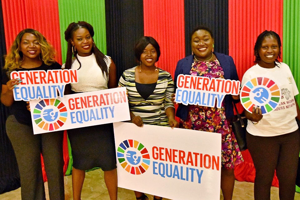 Thelma Kaliu and fellow activists celebrate the launch of the Malawi Chapter of the African Women Leaders Network. Photo: UN Women/Faith Mvula