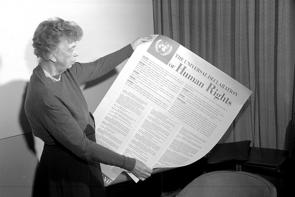 Eleanor Roosevelt of the United States holding a poster of the Universal Declaration of Human Rights. Lake Success, NY, November 1949. UN Photo