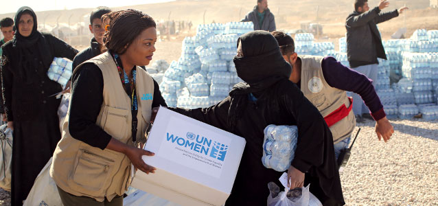 UN Women representatives distribute dignity kits to families living in IDP camps after fleeing the Mosul conflict. Photo: UNAMI